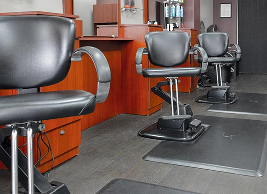Row of chairs at Golden Scissors Barber Shop